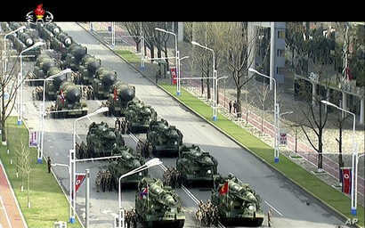 In this image made from video broadcast by North Korean broadcaster KRT, military vehicles prepare for a parade at Kim Il Sung Square in Pyongyang, April 15, 2017. North Korean leader Kim Jong Un has appeared in a massive parade in the capital, Pyong...