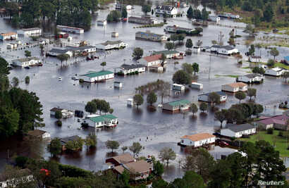 Houses sit in floodwater caused by Hurricane Florence, in this aerial picture, on the outskirts of Lumberton, North Carolina, U.S., Sept. 17, 2018.