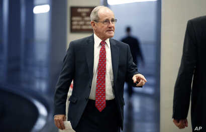 FILE - Sen. Jim Risch, R-Idaho, arrives for a vote on Capitol Hill, May 17, 2018, in Washington.