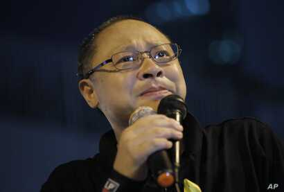 FILE - Founder of the Occupy Central civil disobedience movement Benny Tai cries during a rally outside government headquarters after protesters were threatened by residents and pro-Beijing supporters in Kowloon's crowded Mong Kok district.