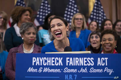 Rep. Alexandria Ocasio-Cortez, D-N.Y., smiles as she speaks at an event to advocate for the Paycheck Fairness Act on the 10th anniversary of President Barack Obama signing the Lilly Ledbetter Fair Pay Act.
