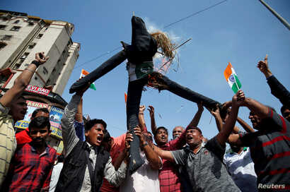 People burn an effigy depicting Pakistan as they celebrate after Indian authorities said their jets conducted airstrikes on militant camps in Pakistani territory, in Ahmedabad, India, February 26, 2019.