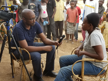 Voice of America reporter Edward Rwema interviews Jacqueline Nduwayezu , 47-year-old mother of six in Mahama Refugee camp, which is home to more than 54,000 Burundian refugees in easter Rwanda.