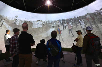 """""""Forced From Home"""" uses interactive media like 360-degree video to depict the humanitarian work being done by Médecins Sans Frontières (B. Allen/VOA)"""