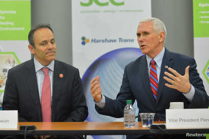 Vice President Mike Pence, sitting with Kentucky Governor Matt Bevin, discusses the Republican replacement for the American Care Act (aka Obamacare) during a meeting with local business leaders in Louisville, Kentucky, March 11, 2017.