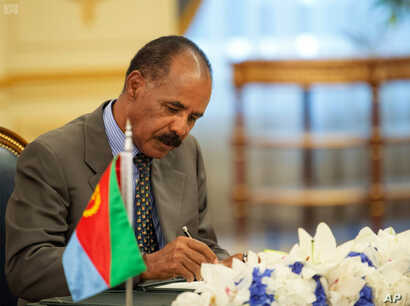 FILE - Eritrean President Isaias Afwerki signs a peace accord with Ethiopia in Jiddah, Saudi Arabia on Sunday, Sept. 16, 2018.