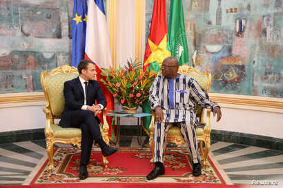 French President Emmanuel Macron attends a meeting with Burkina Faso's President Roch Marc Christian Kabore at the Presidential Palace in Ouagadougou, Burkina Faso, Nov. 28, 2017.