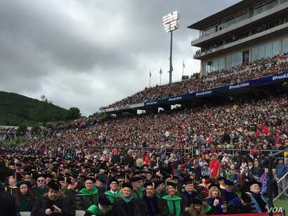 Not an empty seat can be seen in the 34,000-seat Liberty University football stadium as new graduates get set to hear from President Donald Trump. (C. Presutti/VOA)