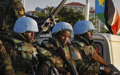 U.N. peacekeepers from Rwanda wait to escort members of the U.N. Security Council as they arrive at the airport in Juba, South Sudan, Sept. 2, 2016. The envoys arrived Friday to press the government to allow another 4,000 peacekeepers into South Suda...