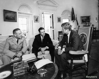 President Kennedy (R) meets with Secretary of Defense Robert S. McNamara and Chairman of the Joint Chiefs of Staff General Maxwell D. Taylor (L) in the Oval Office at the White House on Oct. 2, 1963.