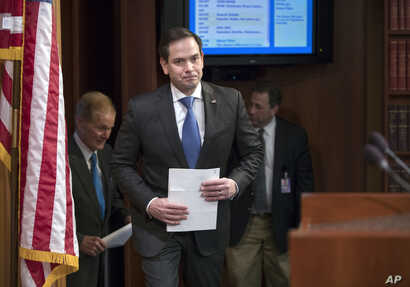 FILE - Sen. Marco Rubio (Republican-Florida) arrives for a news conference at the Capitol in Washington, March 7, 2018.