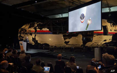 A video show the impact of a missile on Malaysia Airline Flight 17 during a press conference in Gilze-Rijen, the Netherlands, Oct. 13, 2015.