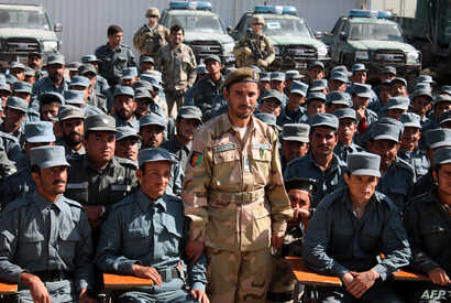 FILE - Afghan General Abdul Raziq (C), police chief of Kandahar, poses for a picture during a graduation ceremony at a police training center in Kandahar province, Afghanistan, Feb. 19, 2017.