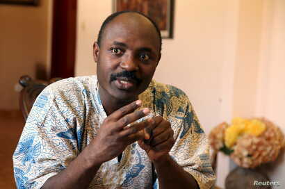 FILE - Journalist Rafael Marques is interviewed at his home in Luanda, Angola, May 12, 2015.