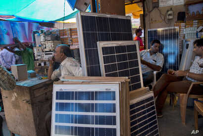Solar panels are displayed for sale at a market in New Delhi, India, Oct. 1, 2015.