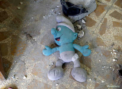 A stuffed toy is found inside an abandoned house previously used by the Islamic State militants in western Mosul, Iraq, June 15, 2017.