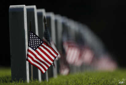 Decorated to mark the Memorial Day holiday, American flags adorn the headstones in Fort Logan National Cemetery, May 28, 2017, in southwest Denver.