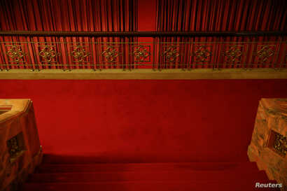 FILE - Red curtains divide interior of the Great Hall of the People where sessions of the National People's Congress and the Chinese People's Political Consultative Conference are held, in Beijing, China, March 6, 2016.