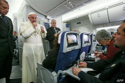 Pope Francis speaks to journalists aboard the flight from Mexico to Italy, on  Feb.  18, 2016.