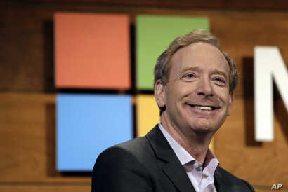 FILE - Microsoft's Brad Smith, president and chief legal officer, speaks at the annual Microsoft shareholders meeting in Bellevue, Wash., Nov. 30, 2016.