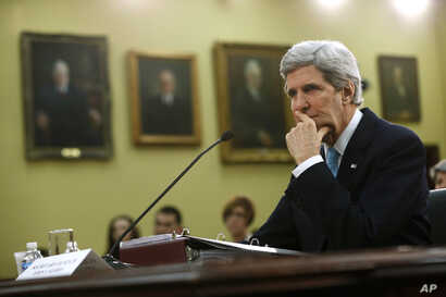 Secretary of State John Kerry pauses while testifying on Capitol Hill in Washington, Wednesday, March 12, 2014, before the House Appropriations subcommittee on State, Foreign Operations, and Related Programs Budget hearing.  Kerry sais he will travel