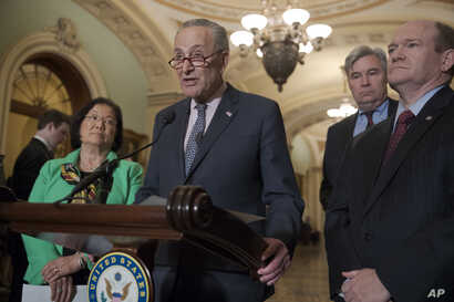 Senate Minority Leader Chuck Schumer, D-N.Y., joined (L-R) by Sen. Mazie Hirono, D-Hawaii, Sen. Sheldon Whitehouse, D-R.I., and Sen. Chris Coons, D-Del., insists that President Donald Trump has made it clear he's considering firing Special Counsel Ro...