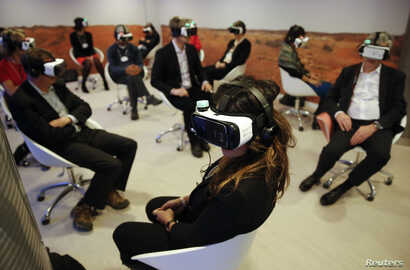 Participants attend the 'Collisions. A Virtual Reality World Premiere' event at the annual meeting of the World Economic Forum (WEF) in Davos, Switzerland January 21, 2016.