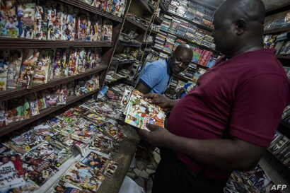Customers look at Nollywood movies in a shop at Idumota market in Lagos, Nigeria, Feb. 19, 2019.