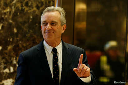 FILE - Robert F. Kennedy Jr. enters the lobby of Trump Tower in Manhattan, New York, Jan. 10, 2017.
