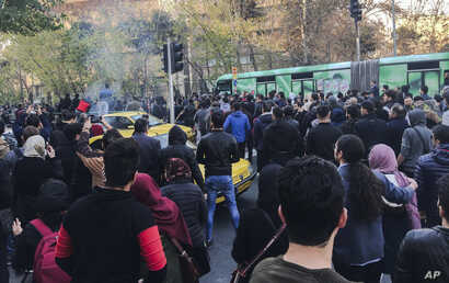 This photo taken by an individual not employed by the Associated Press and obtained by the AP outside Iran, demonstrators attend a protest over Iran's weak economy, in Tehran, Iran, Dec. 30, 2017.