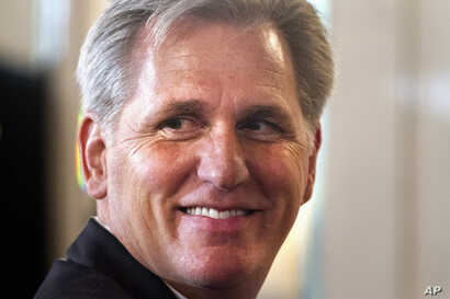 FILE - House Majority Leader Kevin McCarthy of Calif. smiles after finishing a speech about foreign policy,.