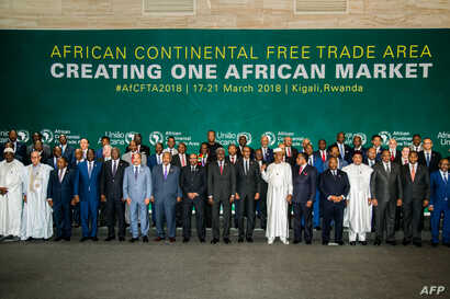 The African Heads of States and Governments pose during African Union (AU) Summit for the agreement to establish the African Continental Free Trade Area in Kigali, Rwanda, on March 21, 2018. / AFP PHOTO / STR