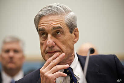 Then-FBI Director Robert Mueller testifies on Capitol Hill in Washington, June 13, 2013.