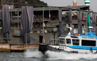 A Turkish coast guard boat patrols in front of the Reina nightclub by the Bosphorus, which was attacked by a gunman, in Istanbul, Jan. 1, 2017.