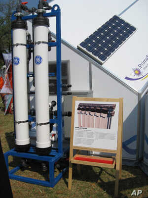 Solar panel and GE water purifier on the HabiHut shelter roof