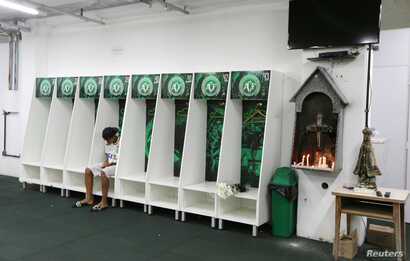 Leandro Bastos of Chapecoense's under-15 soccer team sits inside the team's locker room at the Arena Conda stadium in Chapeco, Brazil, Nov. 29, 2016.