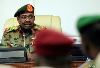 FILE - Sudan's President Omar al-Bashir is seen during a swearing-in ceremony of new officials after he dissolved the central and state governments in Khartoum, Sudan, Feb. 24, 2019.
