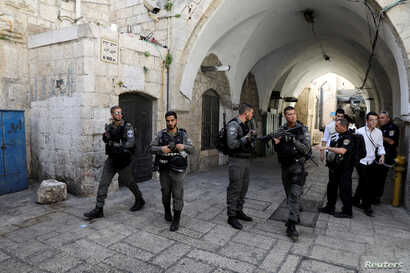 Israeli border police secure the area near the scene of the shooting attack in Jerusalem's Old City, July 14, 2017.