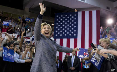 Democratic presidential candidate Hillary Clinton arrives to a cheering crowd to speak at a campaign event at the Grady Cole Center in Charlotte, N.C., Monday, March 14, 2016.