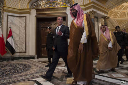 U.S. Secretary of Defense Ash Carter walks with Saudi Arabia's Deputy Crown Prince and Minister of Defense Mohammed bin Salman as Carter arrives for the Gulf Cooperation Council Defense Ministerial in Riyadh, Saudi Arabia, April 20, 2016.