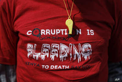 A whistle hangs over a protester's t-shirt during an anti-corruption demonstration by hundreds of protesters who marched to the Parliament and Supreme Court in downtown Nairobi, Kenya, May 31, 2018.