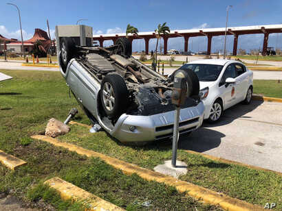 An overturned car is shown at the airport after Super Typhoon Yutu hit the U.S. Commonwealth of the Northern Mariana Islands, Oct. 26, 2018, in Garapan, Saipan.