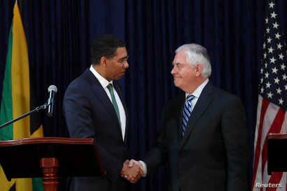 Jamaica's Prime Minister Andrew Holness and U.S. Secretary of State Rex Tillerson shake hands in Kingston, Jamaica, Feb. 7, 2018.