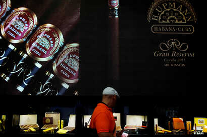 A visitor looks at cigars on display at the 19th Habanos Festival in Havana, Cuba, Feb. 27, 2017.