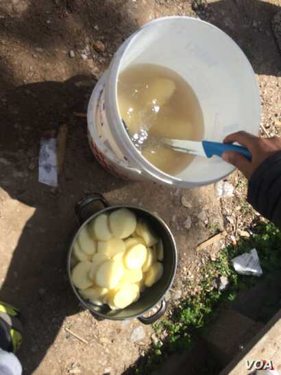In Lesbos' last known 'free' camp, where people can come or go as they please, residents say there is very little to eat, and boiled potatoes are their main source of nutrition in Lesbos, Greece, April 4, 2016. (H. Murdock/VOA)