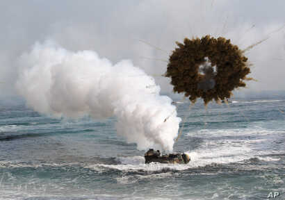 FILE - The 2015 Livelihood Award honors the Marshall Islands prime minister and people for suing nuclear powers over their failure to disarm. Shown here is a South Korean marine LVT-7 landing craft sailing through a smoke screen during joint U.S.-Sou...