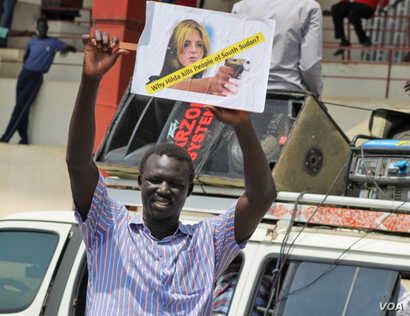 A protester at a rally in Juba on March 10, 2014, holds up a sign against UNMISS head Hilde Johnson.