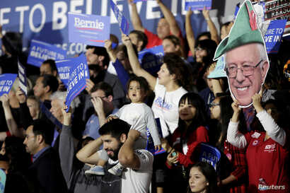 Supporters gather to see U.S. Democratic presidential candidate Bernie Sanders speak during a election night rally in Santa Monica, California, June 7, 2016.
