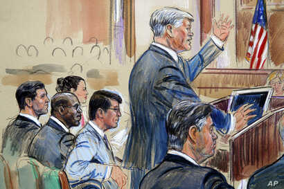 This sketch depicts defense lawyer Kevin Downing asking questions of Rick Gates, as former Trump campaign chairman Paul Manafort, bottom right, listens during Manafort's trial on bank fraud and tax evasion, Aug. 7, 2018.