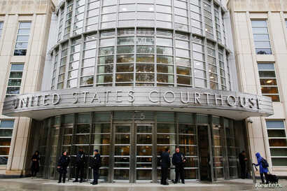 "FILE - Police guard the courthouse of United States District Court for the Eastern District of New York where Joaquin ""El Chapo"" Guzman was brought, in Brooklyn, New York, Nov. 5, 2018."